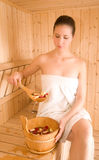 Woman and sauna. And rose Royalty Free Stock Images