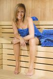 Woman in a sauna with towel Stock Photography