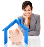 Woman saving for a house Royalty Free Stock Images