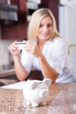 Woman saving money Stock Photo