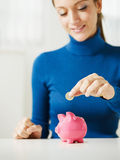 Woman Saving Money In Piggy Bank Stock Images