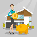 Woman saving money in piggy bank for buying house. Stock Photo