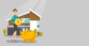 Woman saving money in piggy bank for buying house. Stock Images