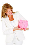 Woman saving in a piggybank Royalty Free Stock Images