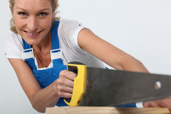 Woman sawing wood Stock Photos
