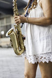 A woman with a sax Stock Image