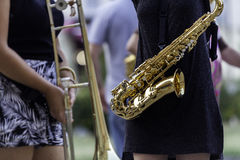 A woman with a sax Royalty Free Stock Image