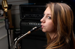 Woman with saxophone. Woman play with silver saxophone stock photos