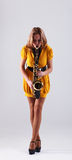 Woman with saxophone. Royalty Free Stock Photography