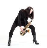 Woman with saxophone. Stock Photos