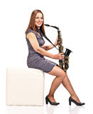 Woman with saxophone isolated on white Stock Photography