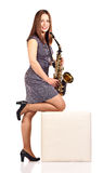 Woman with saxophone isolated on white Stock Photos