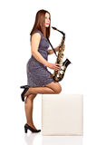 Woman with saxophone isolated on white Stock Images