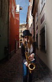 Woman with saxophone in old city Royalty Free Stock Images