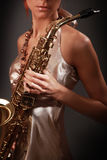 Woman saxophonist Stock Images