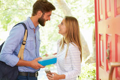 Woman Saying Goodbye To Man Leaving Home With Packed Lunch Royalty Free Stock Images