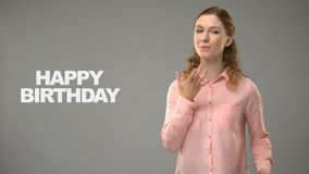 Woman saying happy birthday in asl, text on background, communication for deaf stock video