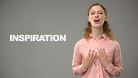 Woman saying inspiration in sign language, text on background, communication stock footage