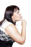 Woman saying shh Stock Image