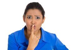 Woman saying silence Stock Photography