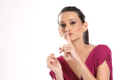 Woman saying silent gesture Royalty Free Stock Photo