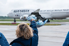 A woman says goodbye to Iron Maiden's Boeing 747 Ed Force One Royalty Free Stock Images