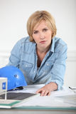 Woman with model of housing Royalty Free Stock Photography