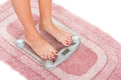 Woman on scales Stock Image
