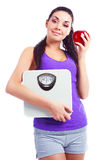 Woman with scales and apple Royalty Free Stock Image