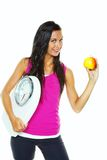 Woman with scales after a successful diet Stock Images