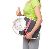 Woman with scales Stock Photography