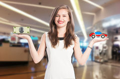 Woman scaling money and new car Stock Image
