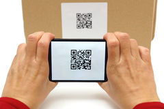 Woman scan qr code on box Royalty Free Stock Image