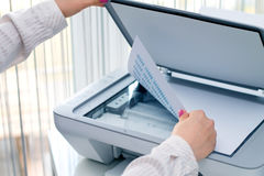 Woman scan some documents  Stock Photography