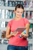 Woman Scanning Product Through Digital Tablet In Royalty Free Stock Images