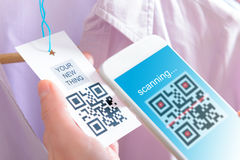 Woman scanning QR code Stock Photos