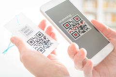 Woman scanning QR code Stock Images