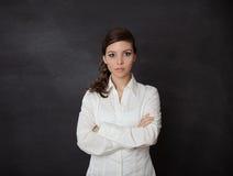 Woman scared blackboard Royalty Free Stock Photo