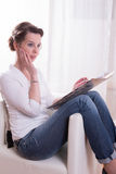 Woman scared by content of file Royalty Free Stock Photography
