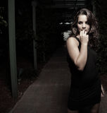 Woman scared of the dark. Image of a young woman in fear of the dark royalty free stock images