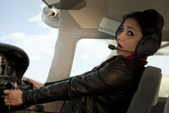 Woman scared flying airplane Stock Image