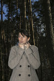 Woman scared in forest Royalty Free Stock Photos