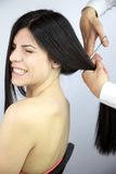 Woman scared of haircut. Female model scared about getting her long hair cutted Royalty Free Stock Image