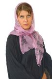 The woman in a scarf. On a white background stock image