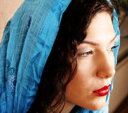 Woman with scarf. Beautiful woman with blue scarf Royalty Free Stock Image