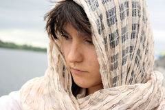 Woman in scarf. On her head looking sad. Arabic style portrait of a young beauty girl Royalty Free Stock Photography