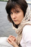 Woman in scarf. Portrait of beautiful haughty woman in scarf on her head Royalty Free Stock Photos