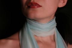 Woman with scarf. And red lips on black Stock Photography