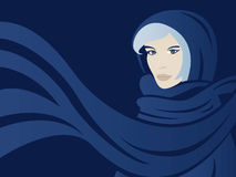 Woman with scarf. Face of a beautiful woman with scarf with blue background Royalty Free Stock Photo