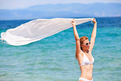 Woman with scarf on the beach Stock Image